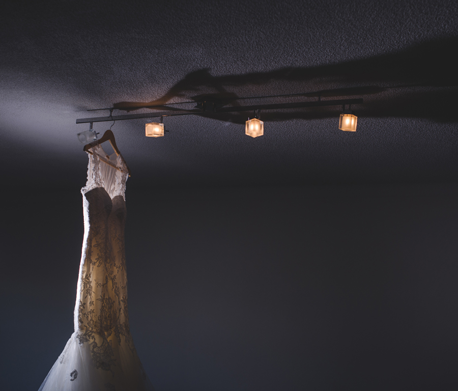 Rosalynn Win Haute Couture bridal dress hanging from ceiling