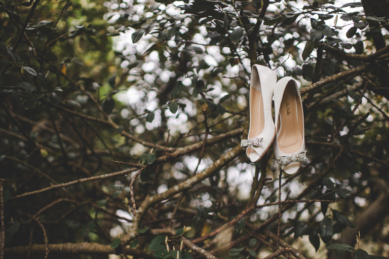 Bride's Cinderella Bella wedding shoes hanging from the trees in Bowral