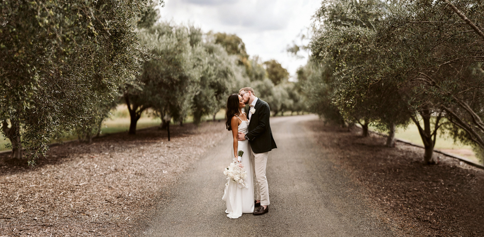Tina and Matt down the lane at their Greystone Estate wedding in the Hunter Valley